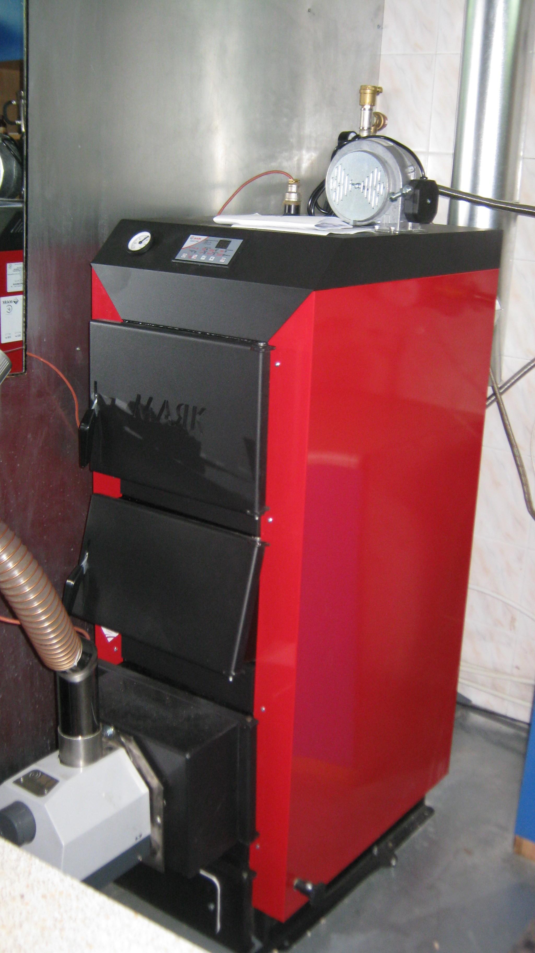Пеллетная горелка,OXI , установленная в котел Маяк KPT ECO MANUAL 30 кВт.